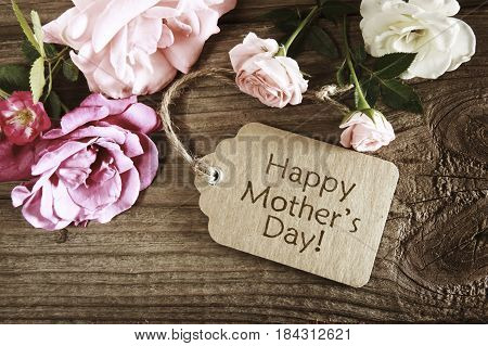 Mothers day card with rustic roses on wooden board