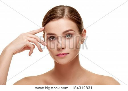 Attractive healthy young woman touching her brow