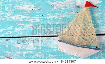 Vintage wooden boat on a green background