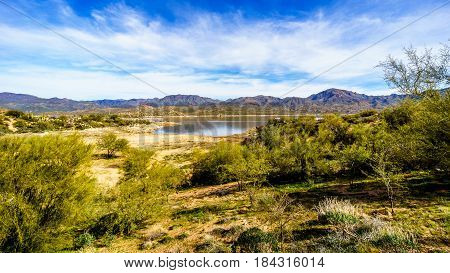 Lake Bartlett surrounded by the semi desert landscape with its many cacti and shrubs in Tonto National Forest in Maricopa County Arizona USA