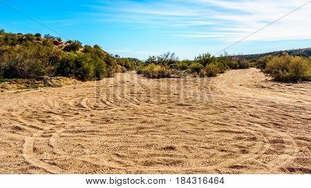 The desert landscape with its many dirt trails for outdoor activities along the Bartlett Dam Road in Tonto National Forest in Maricopa County Arizona USA