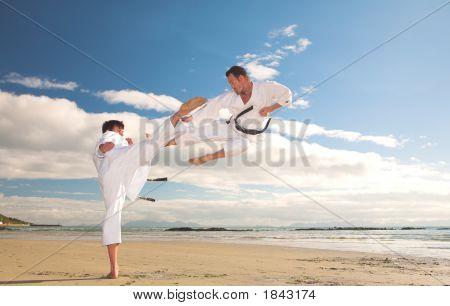 Men Practicing Karate On The Beach
