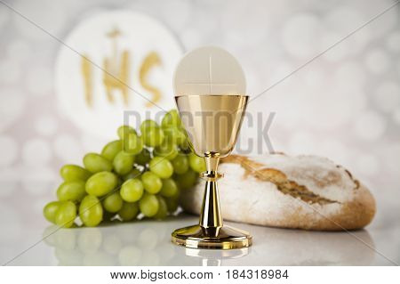 Holy communion a golden chalice composition isolated on white