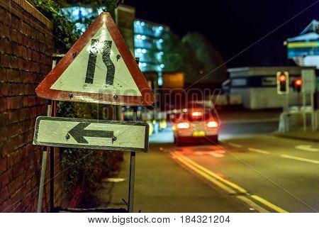Night View Road Narrows UK Roadworks Sign.