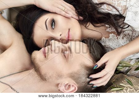 Bride and groom are getting ready in the morning for the wedding. Loving couple hugging at home. Handsome groom and charming bride. Couple get ready wedding ceremony