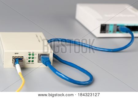 1Gbps optical media converter with SFP module connected to ethernet port office router