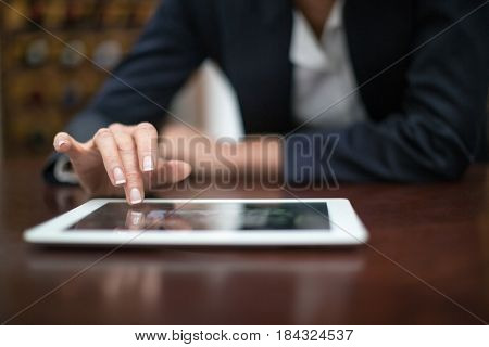 Close-up of businesswoman using digital tablet in a restaurant