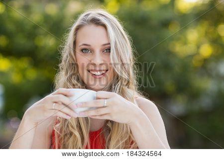 Portrait of beautiful woman having coffee in the restaurant