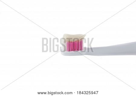 white plastic toothbrush with a bristle of white and pink color and toothpaste on a white background