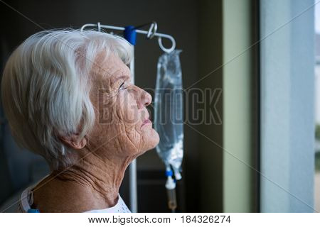 Close-up of thoughtful senior patient standing at hospital