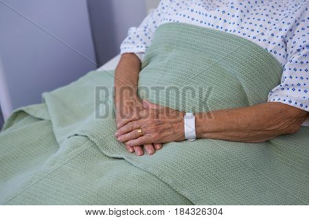 Senior patient relaxing on bed at hospital