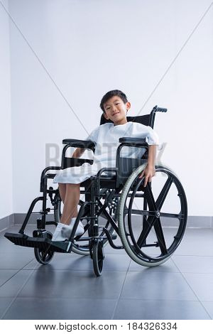 Portrait of a smiling disabled boy patient on wheelchair at hospital
