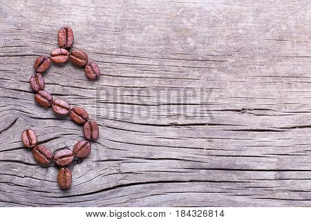 Dollar symbol from coffee beans. Coffee beans on old wooden table