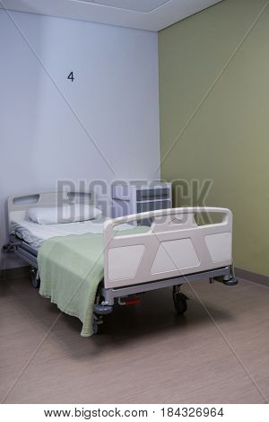 Close-up of empty bed in ward at hospital