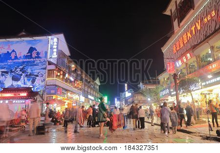YANGSHOU CHINA - NOVEMBER 18, 2016: Unidentified people visit West street. West street is a main commercial street with restaurants bars and gift shops.