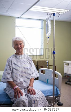 Smiling senior patient at hospital ward in hospital
