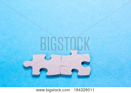 Puzzle pieces with empty space for text on a blue background