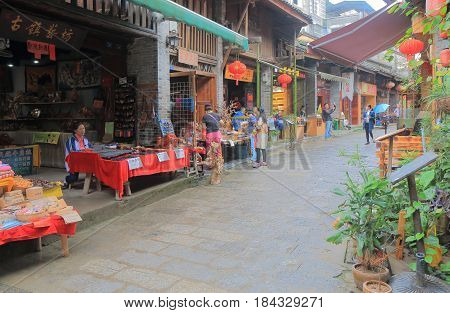 YANGSHOU CHINA - NOVEMBER 19, 2016: Unidentified people visit Xingping historical village. Xingping is a historical fishing village near Li river.