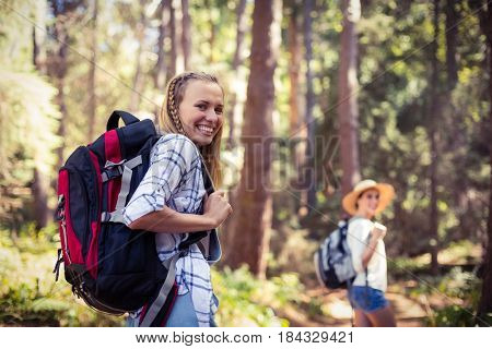 Portrait of beautiful woman walking in forest on a sunny day