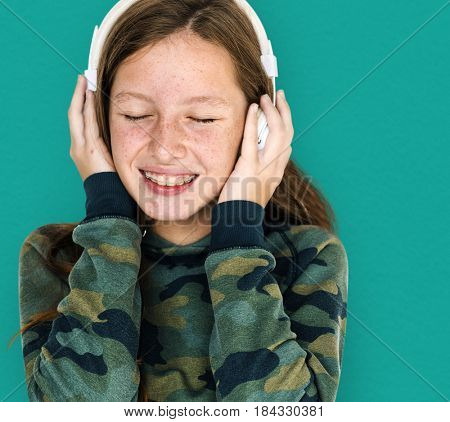 Young caucasian girl with headphone
