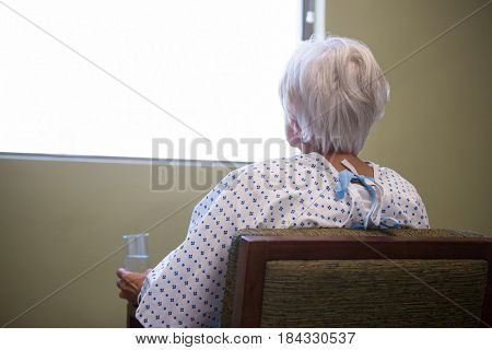 Senior patient siting on chair in hospital