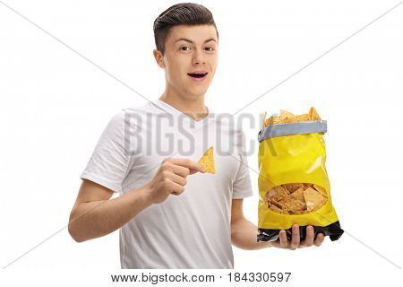 Teenager holding a bag of chips isolated on white background