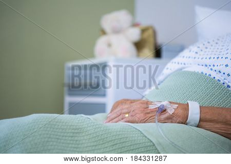 Saline on senior patients hand in hospital