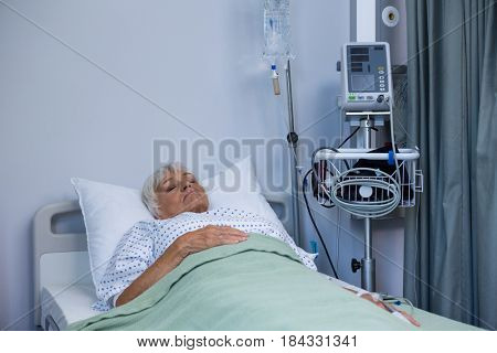 Senior patient lying on bed in hospital