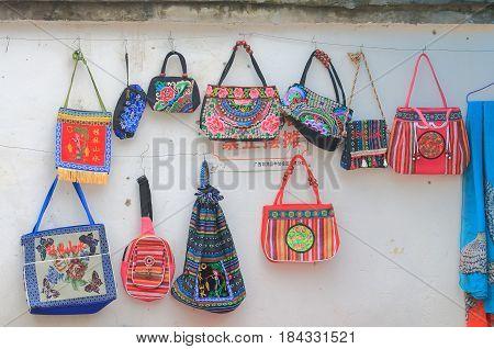 YANGSHOU CHINA - NOVEMBER 19, 2016: Xingping street market souvenir shop sells handicrafts.