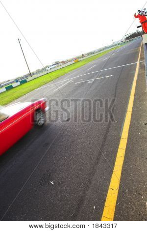 Speeding Racer On Racetrack