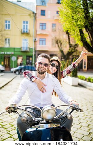 Couple In Love Riding A Motorbike. Young Riders Enjoying Themselves On Trip.