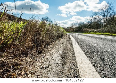 Sunny Day View of Empty UK Country Road.