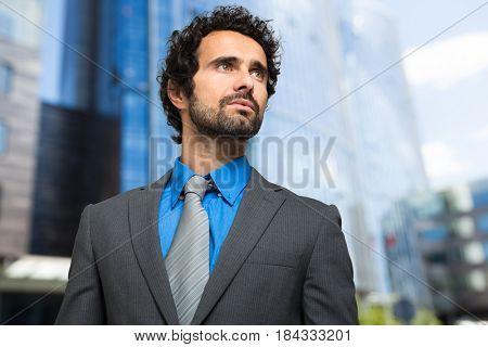 Handsome businessman in a business center