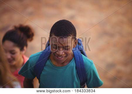 Close-up of student walking through school campus
