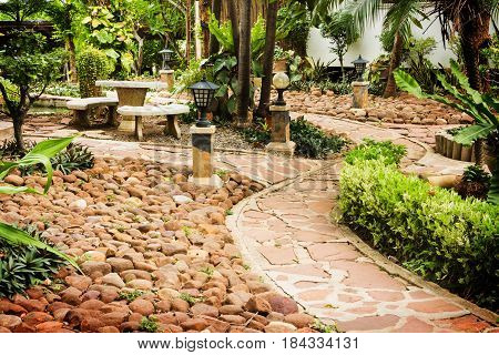 Stone Pathway to residential. Manicured garden design.