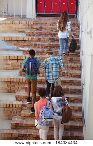 Students moving up staircase at school
