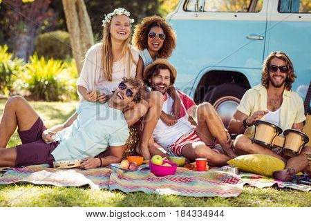 Group of friends having fun together in park on a sunny day