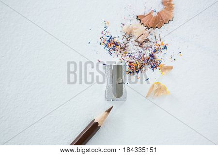 Colored shavings with brown color pencil on white background