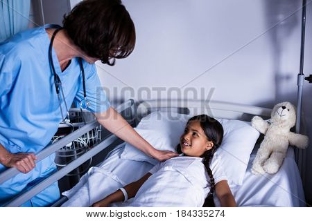 Doctor interacting with patient in hospital