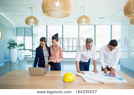 Architects working together in office