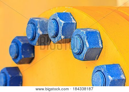 Stud bolt blue and Nuts on vessel for sea offshore wellhead remote platform Oil and GasEnergy and petroleum industry.