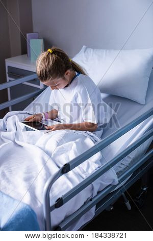 Patient using digital tablet in ward at hospital