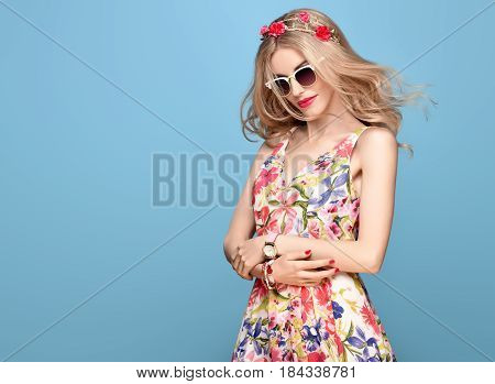Fashion Beauty. Sensual Sexy Blond Model in fashion pose Smiling. Woman in Summer Outfit. Trendy Floral Dress, Stylish wavy hairstyle, fashion Flower Pink Hairband. Playful Happy Romantic summer Girl