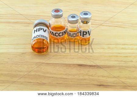 Bottle vaccine of Human papillomavirus (HPV) vaccine on wooden background