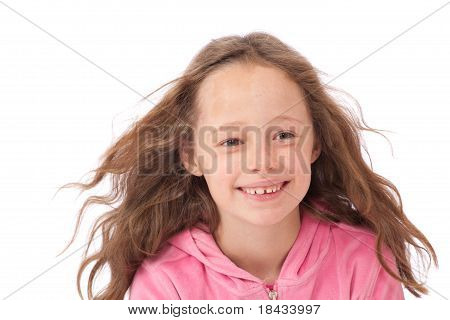 Young Girl Smiling With Wind In Hair