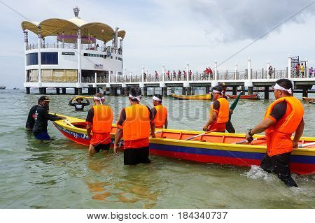 Labuan,Malaysia-April 29,2017:Group of boatman with life jacket participate in a boat tug of war games in Labuan International Sea Sports Complex at Labuan,Malaysia on 29th April 2017.