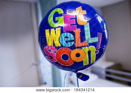 Close-up of get well soon balloon in hospital