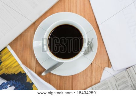 Black coffee served on wooden table