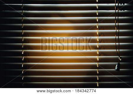 Dark jalousies on sunset background. Horizontal pattern.