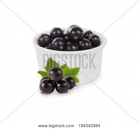 Bowl with blackcurrants isolated on white background. Ripe currants close-up. Background berry. Sweet and juicy berry with copy space for text. Antioxidant and the best berry a source of vitamin C